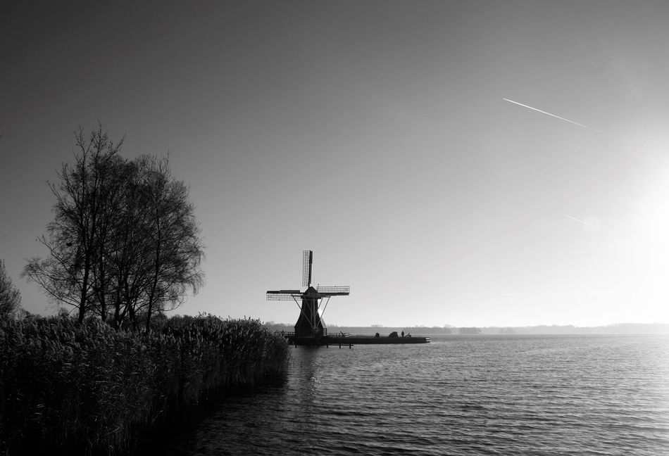 Paterswoldsemeer Groningen The Netherlands Nature Windmill Molen Outdoors Holland Lake Clear Sky Black And White Water Day Beauty In Nature Airplane Autumn Canon1000d