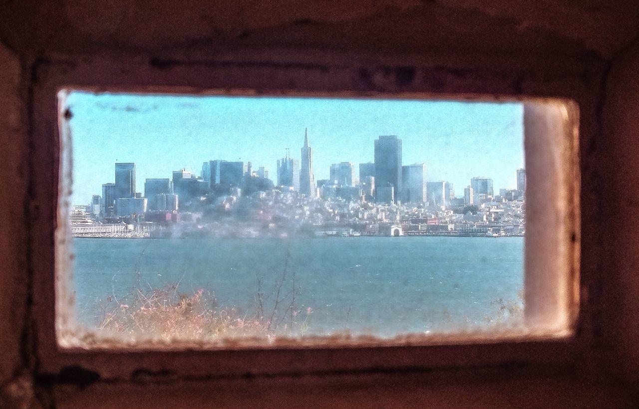 Cityscape Seen Through Small Glass Window