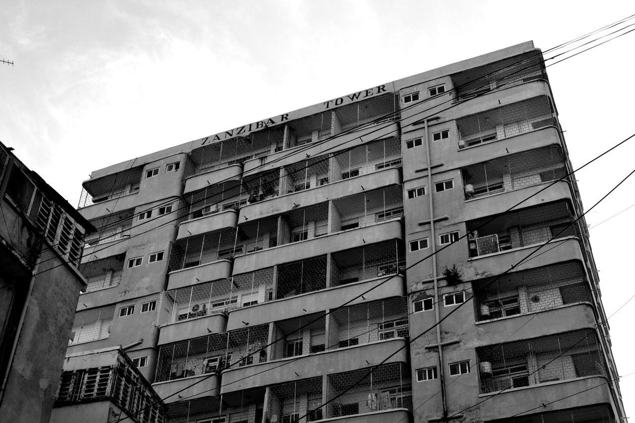 low angle view, building exterior, architecture, window, day, built structure, balcony, outdoors, no people, sky, apartment, city