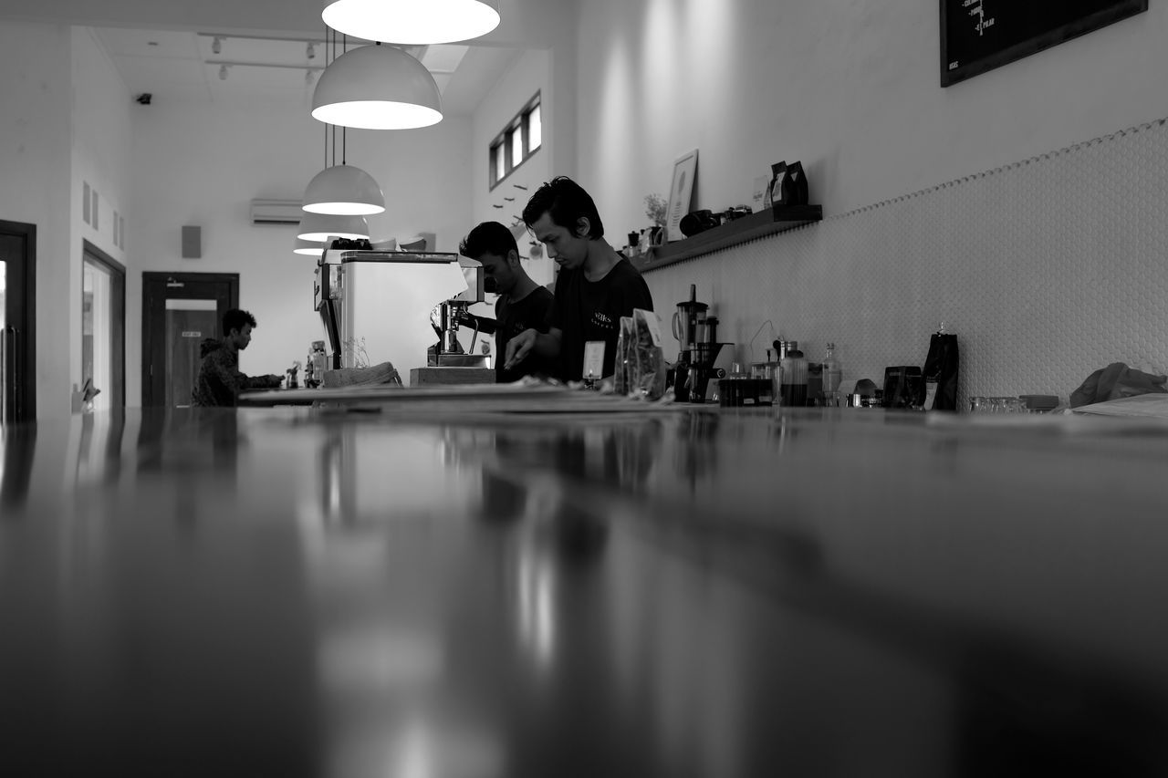 Adult Adults Only Bar Baristas Black And White Boutique Coffee Shop Cafe Cappuccino Copy Space Countertop Environmental Portraits Espresso Espresso Machine Latte Low Angle View Makeportraits Monochrome Night Working Young Adult