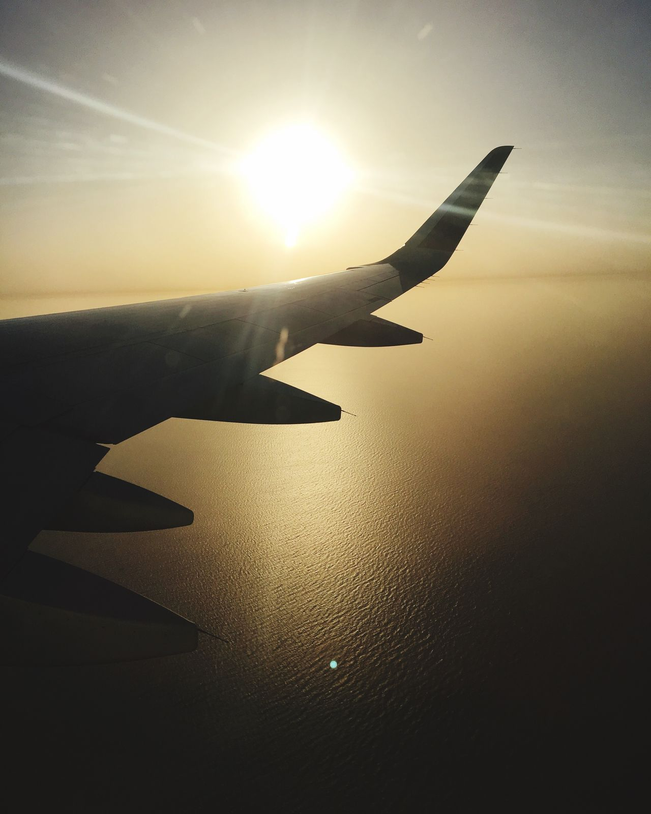 The sea is a beautiful scary place, Flying Airplane Sun Travel Tranquil Scene Beauty In Nature Sea And Sky