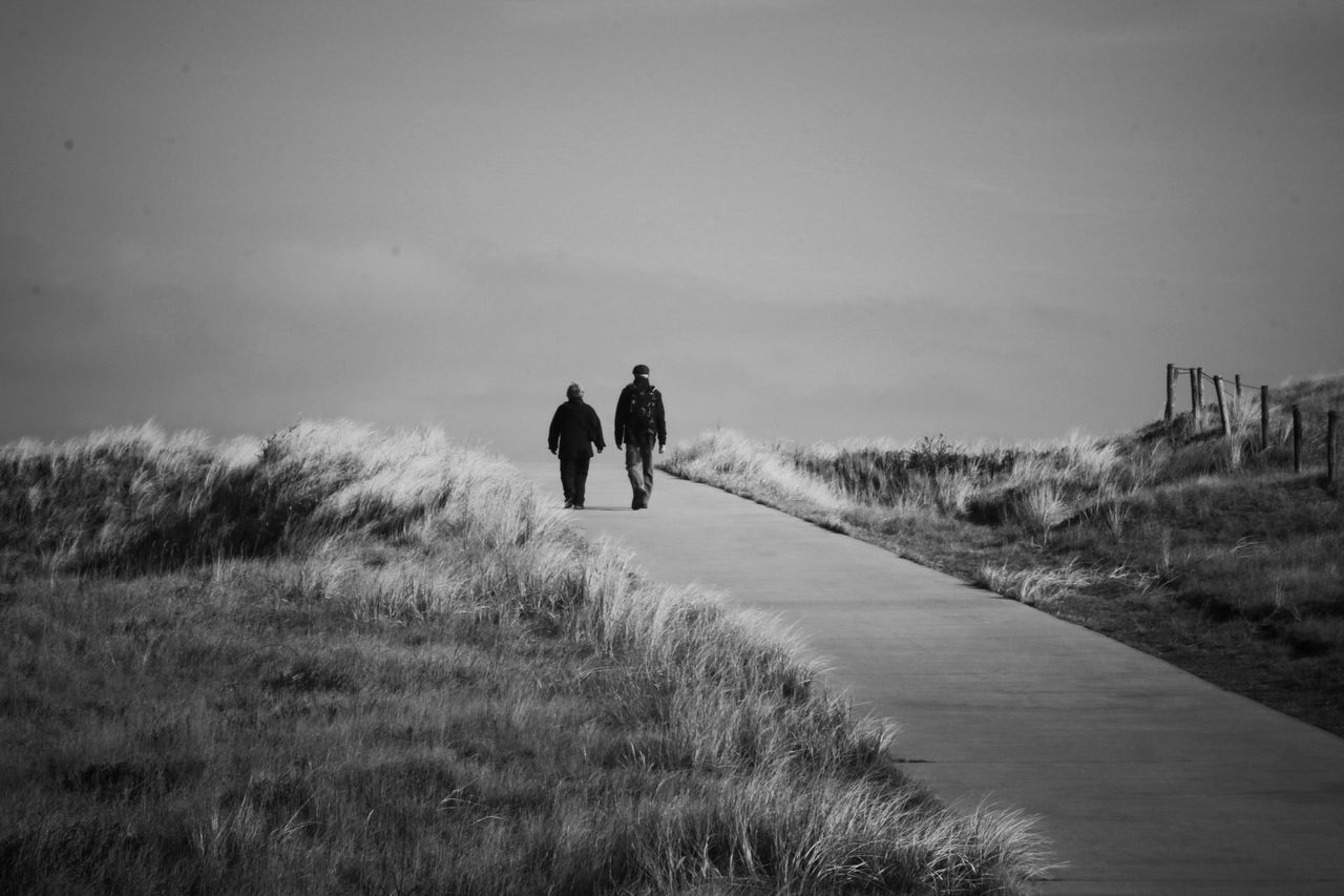 Two People Walking Outdoors Landscape Beauty In Nature Canon EyeEmBestPics Simple Photography Texel  Canon EOS 70D Capture The Moment Eye4photography  The Way Forward People Adults Only Blackandwhite Black And White Real People Power In Nature Island Grass Dutch Countyside