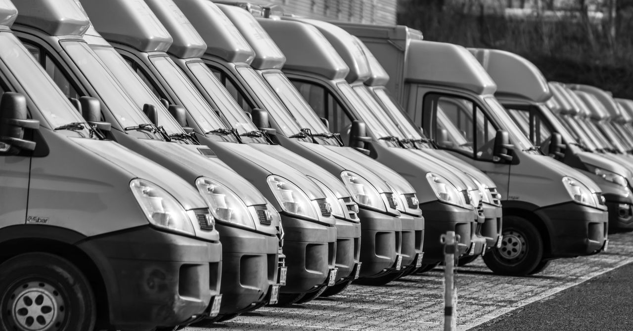 Black & White Black And White Cars Day Fleet In A Row Land Vehicle Large Group Of Objects Logistic Logistics No People Outdoors Road Transportation Transportation Transporter