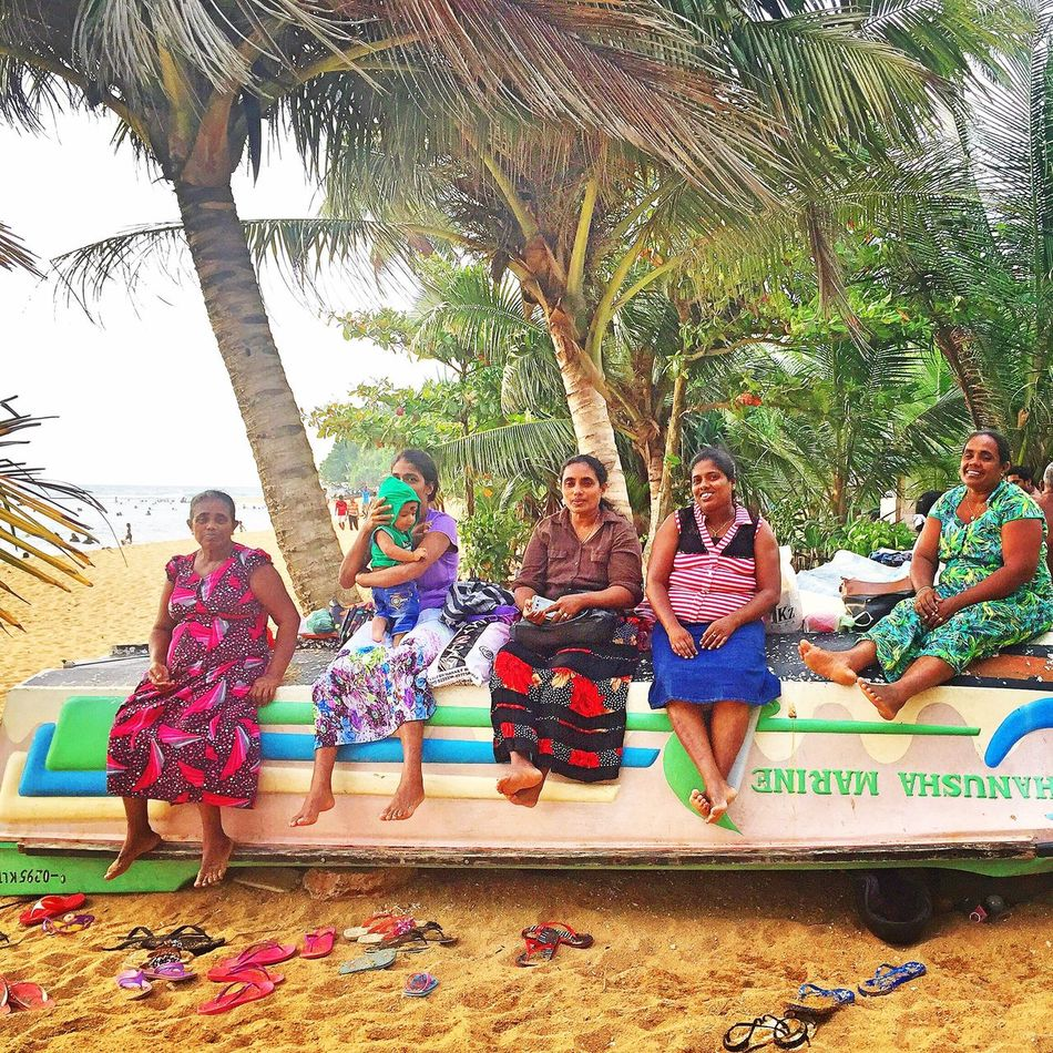 Sri Lanka SriLanka Palm Tree Tree Vacations Togetherness Full Length Beach Enjoyment Adult Happiness Smiling People Fun Summer Friendship Sitting Day Outdoors Lifestyles Cheerful Multi Colored Boat Indian Woman Boats