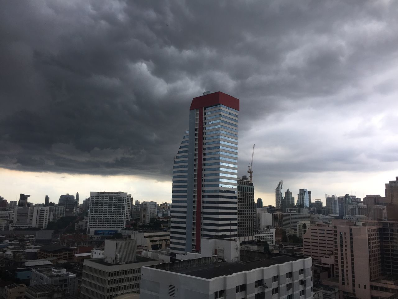 skyscraper, architecture, building exterior, cityscape, city, cloud - sky, built structure, tall - high, modern, sky, tower, urban skyline, no people, outdoors, day, travel destinations, storm cloud