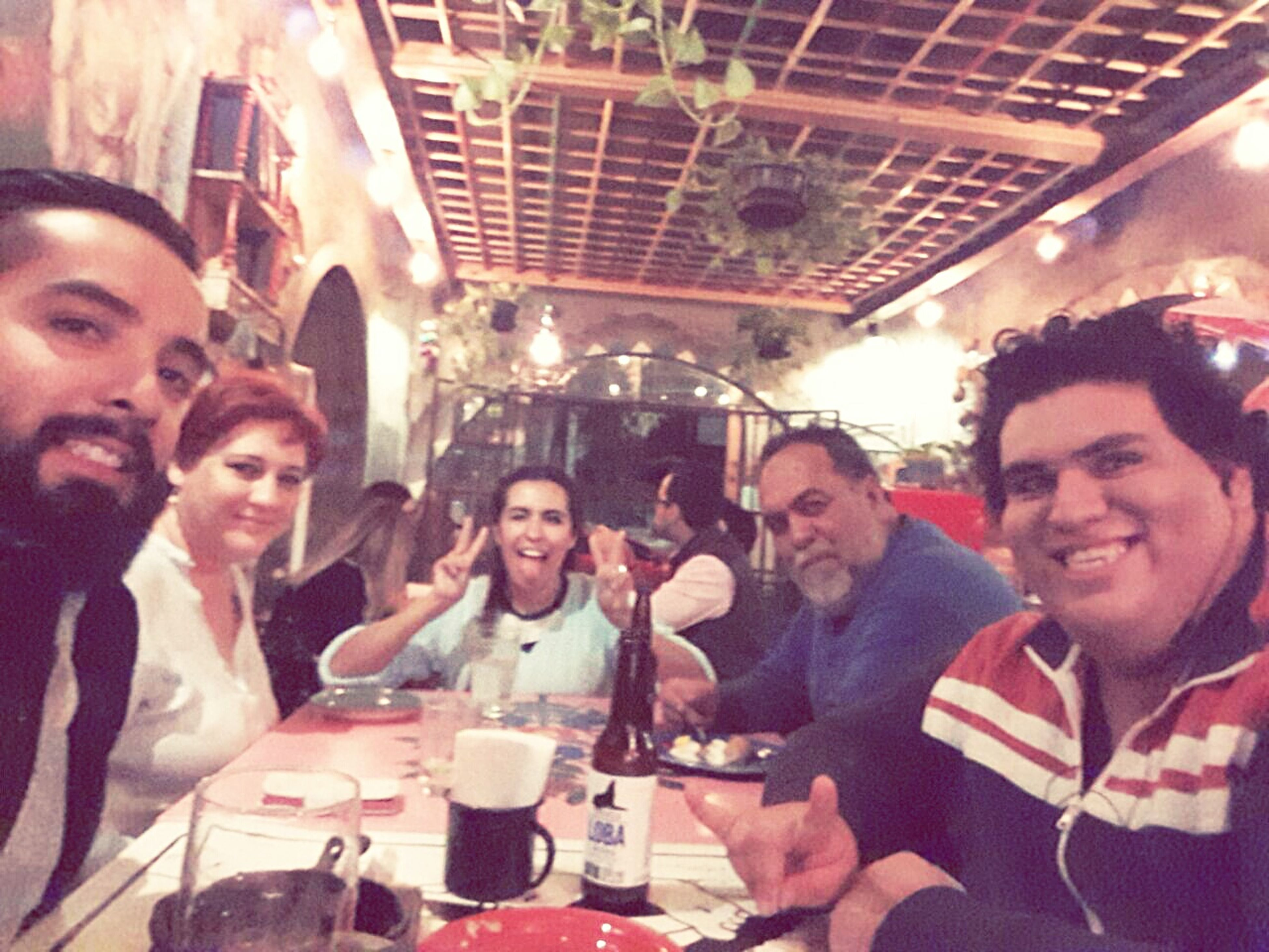friendship, young adult, young women, women, enjoyment, men, adults only, adult, fun, restaurant, togetherness, smiling, drink, food and drink, party - social event, people, city, night, leisure activity, cheerful, indoors, alcohol, happy hour