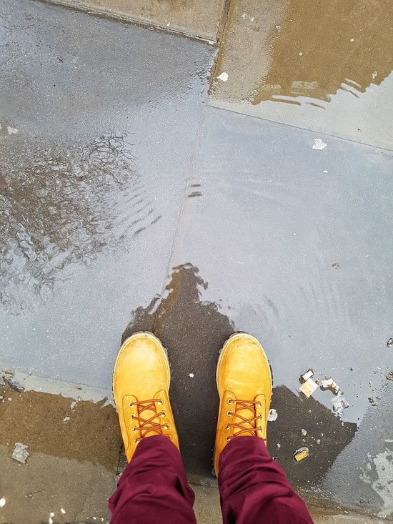 Standing in a puddle with my winter boots and a poorly reflection of myself in the water Man Standing Water Puddle Sidewalk Boots No Movement Stillness Winter Cold Childish Behaviour Happy Blur Reflection Cristal City London Tourism Walking Tour Resting