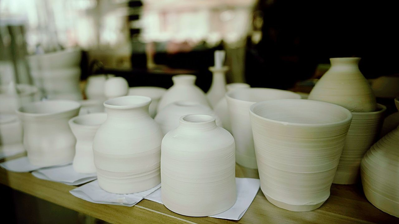 indoors, no people, earthenware, focus on foreground, large group of objects, close-up, day