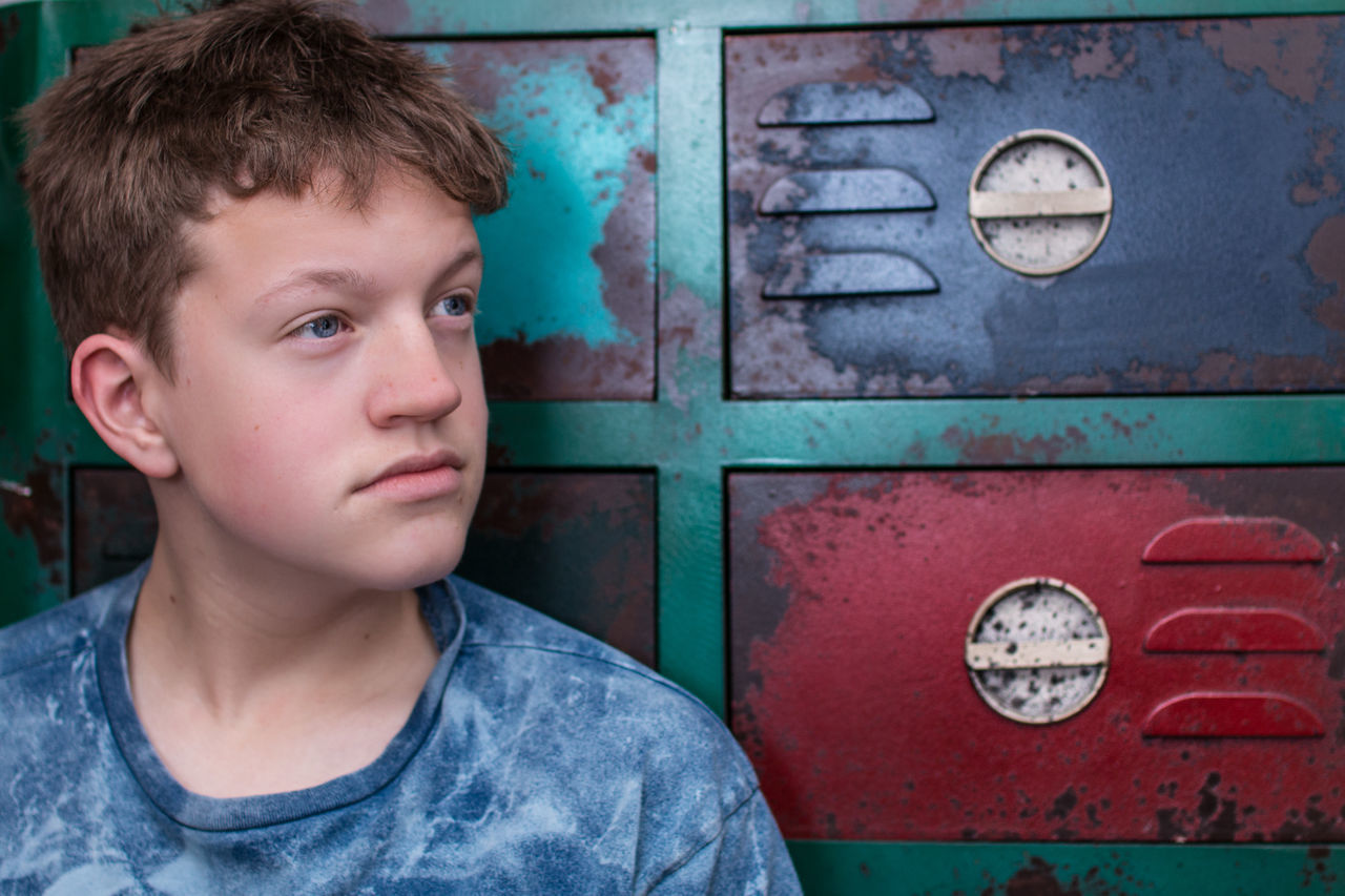 reflecting Blue Boy Cabinet Child Colours Day Handsome Handsome Teenage Boy Headshot People Portrait Red Rusty Cabinet Son Streamzoofamily Teenager Thinking Teenager