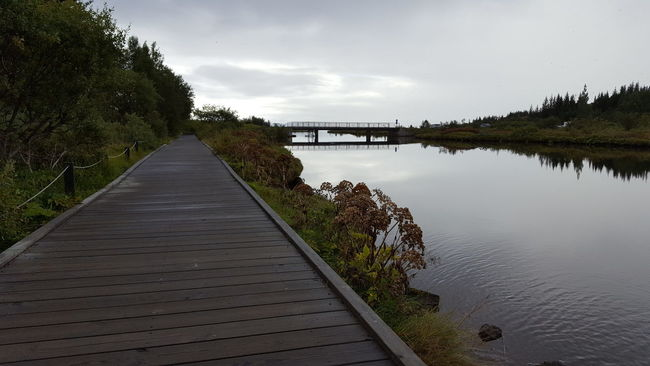 Beauty In Nature Boardwalk Cloud Cloud - Sky Day Diminishing Perspective Footpath Lake Long Narrow Nature No People Non-urban Scene Outdoors Pier Pingvellir Reflection Scenics Sky The Way Forward Thingvellir National Park Tranquil Scene Tranquility Tree Water