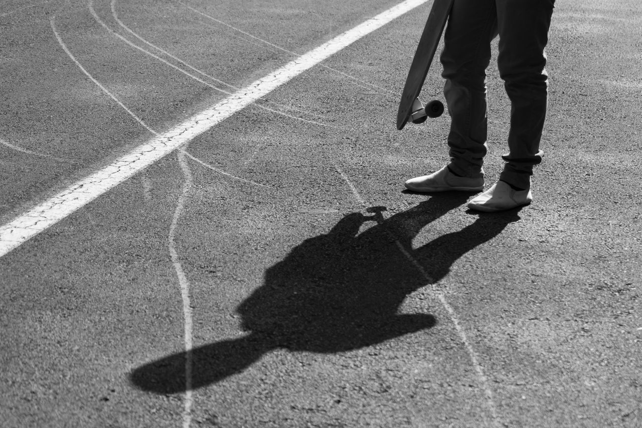Blackandwhite Blackandwhite Photography Casual Clothing City Life Day Fine Art Photography Focus On Shadow Ground Leisure Activity Lifestyles Longboarding Monochrome Outdoors Road Road Marking Shadow Silhouette Skate Skateboarding Street Streetphoto_bw Streetphotography Sunlight The City Light Unrecognizable Person