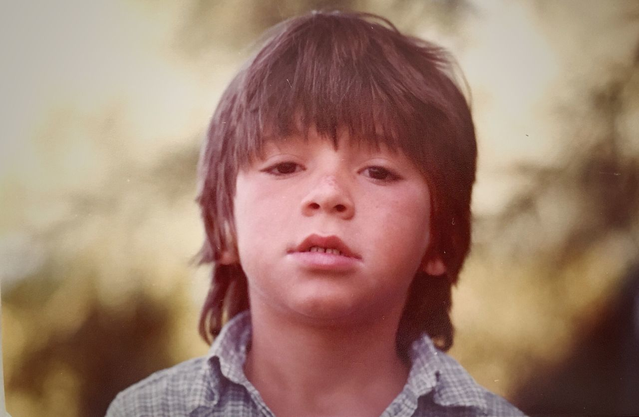 Sweet wild boy Headshot One Person Boy Real People Childhood Head And Shoulders Close-up Elementary Age Front View Portrait Day Children Children Only EyeEmNewHere Forever Young Young Men Innocence Vintage Photo Retro