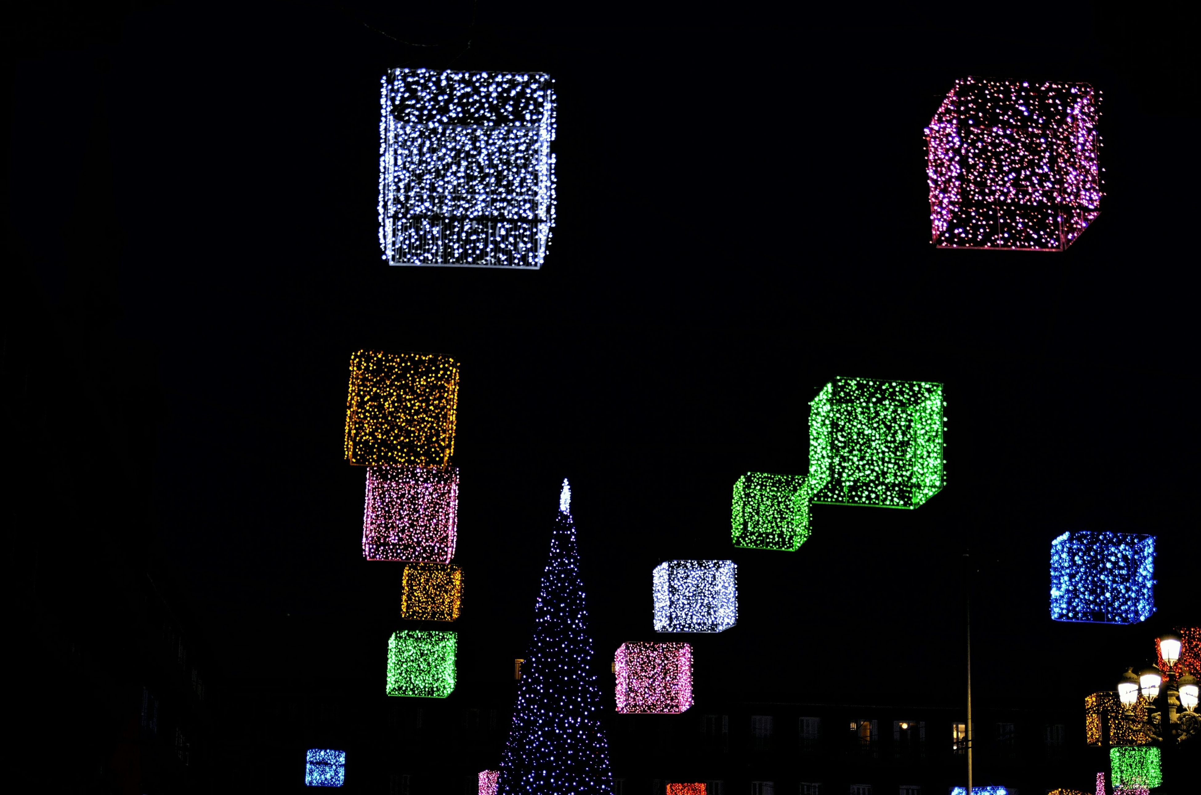 illuminated, night, text, communication, low angle view, hanging, multi colored, western script, decoration, indoors, no people, christmas, celebration, lighting equipment, variation, blue, abundance, number, dark, non-western script