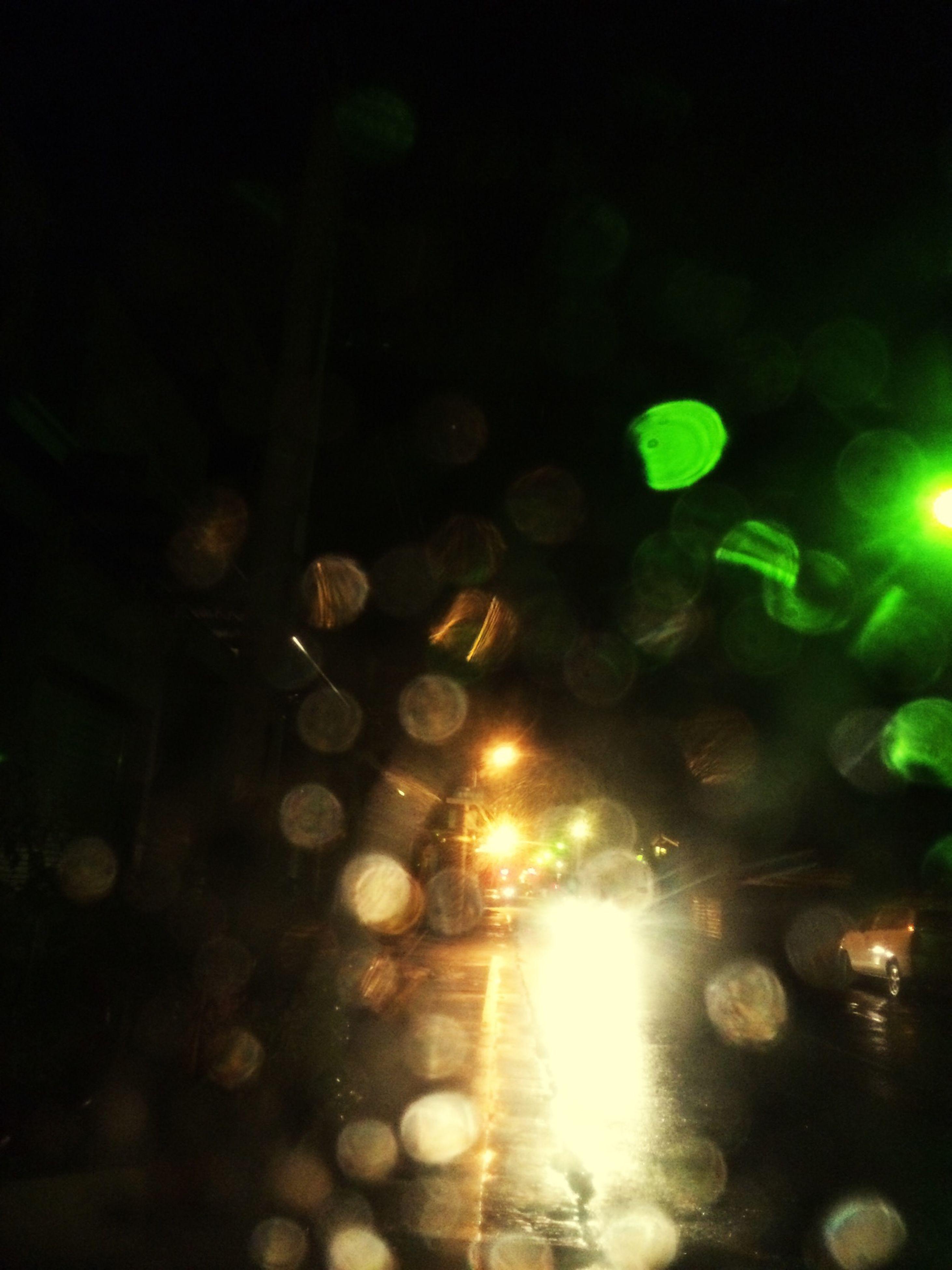 illuminated, night, lens flare, transportation, car, street, land vehicle, street light, light - natural phenomenon, defocused, lighting equipment, road, glowing, mode of transport, blurred motion, motion, wet, outdoors, city street, light beam