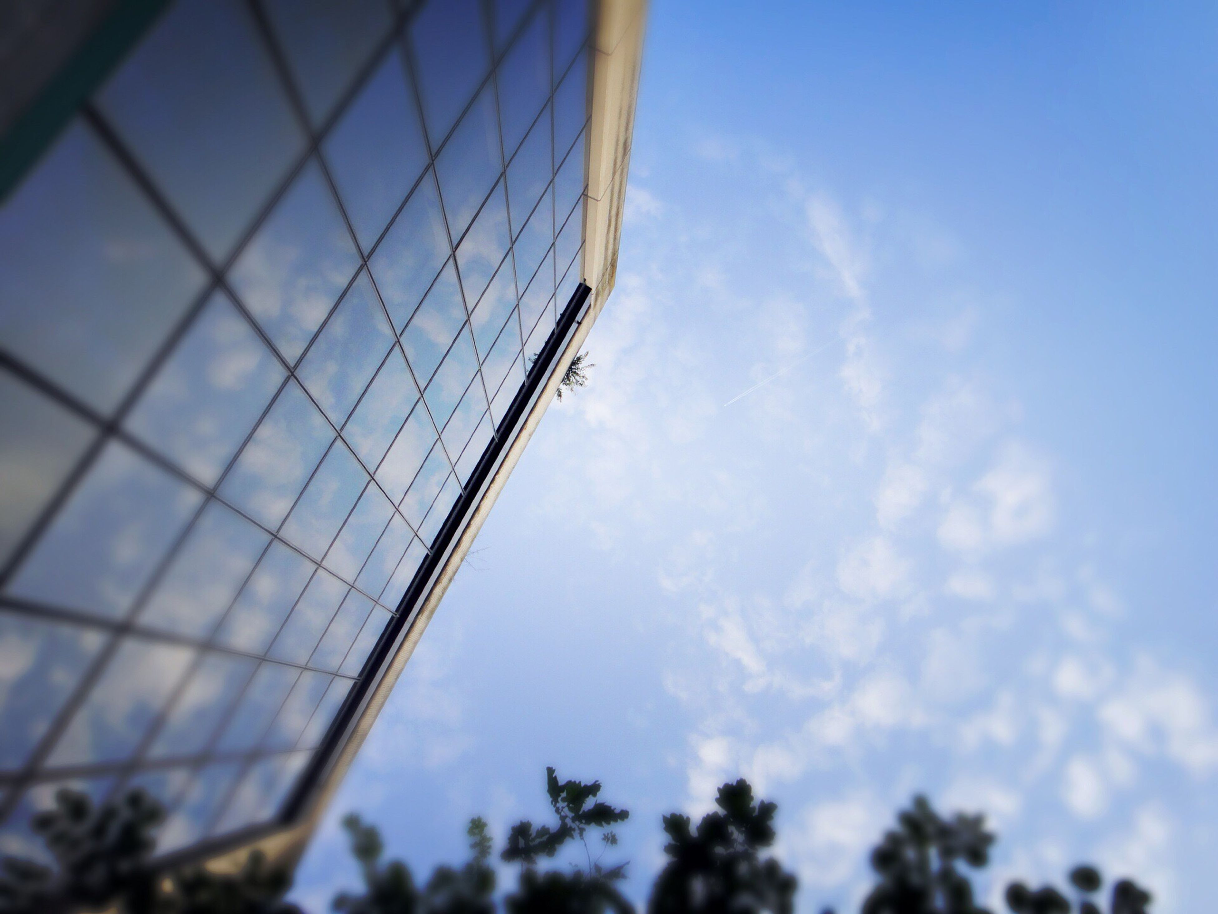 low angle view, sky, built structure, architecture, cloud - sky, cloud, metal, day, connection, no people, cloudy, blue, outdoors, metallic, tree, building exterior, nature, glass - material, sunlight, modern