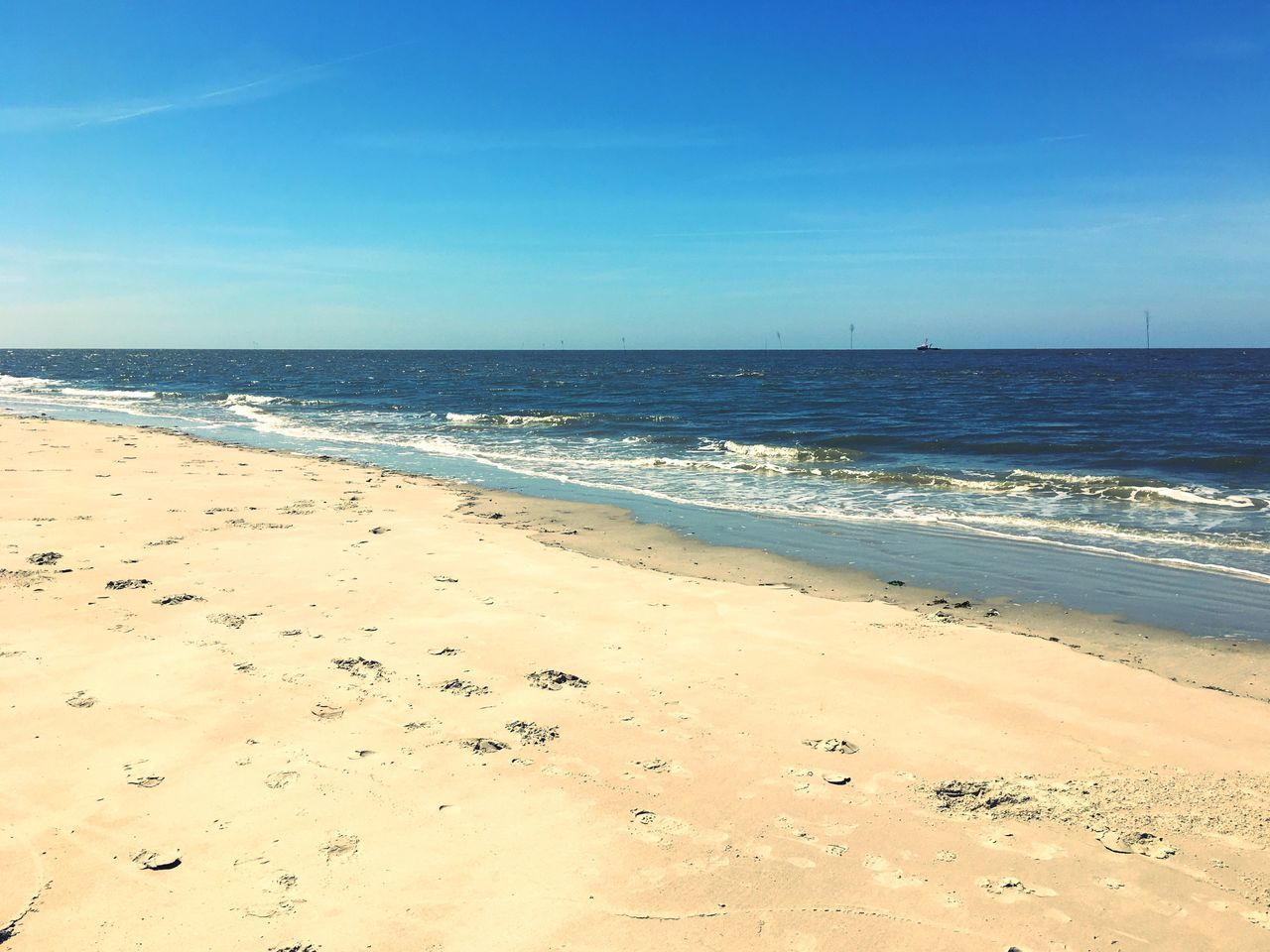 Beach Sea Sand Horizon Over Water Scenics Beauty In Nature Nature Tranquil Scene Water Shore Tranquility Outdoors Sky No People Travel Destinations Day Blue Sunlight Wave Clear Sky