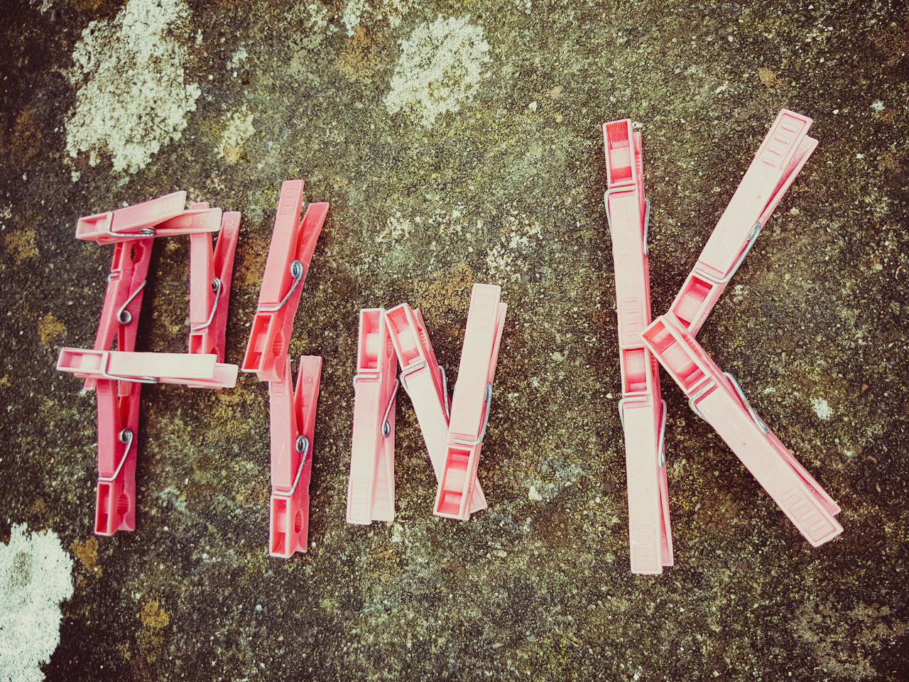 The word Pink spelt out with bright Pink clothes pegs on a stone background. Text No People Outdoors Day Affection Housework Laundry Pegs Romantic Pictures Samsung Galaxy S7 Edge Communication Text Smartphonephotography My Smartphone Life Artphotography EyeEmNewHere Art Photography Pink Color Colour Image Words In Picture Spelling Artphoto Millennial Pink