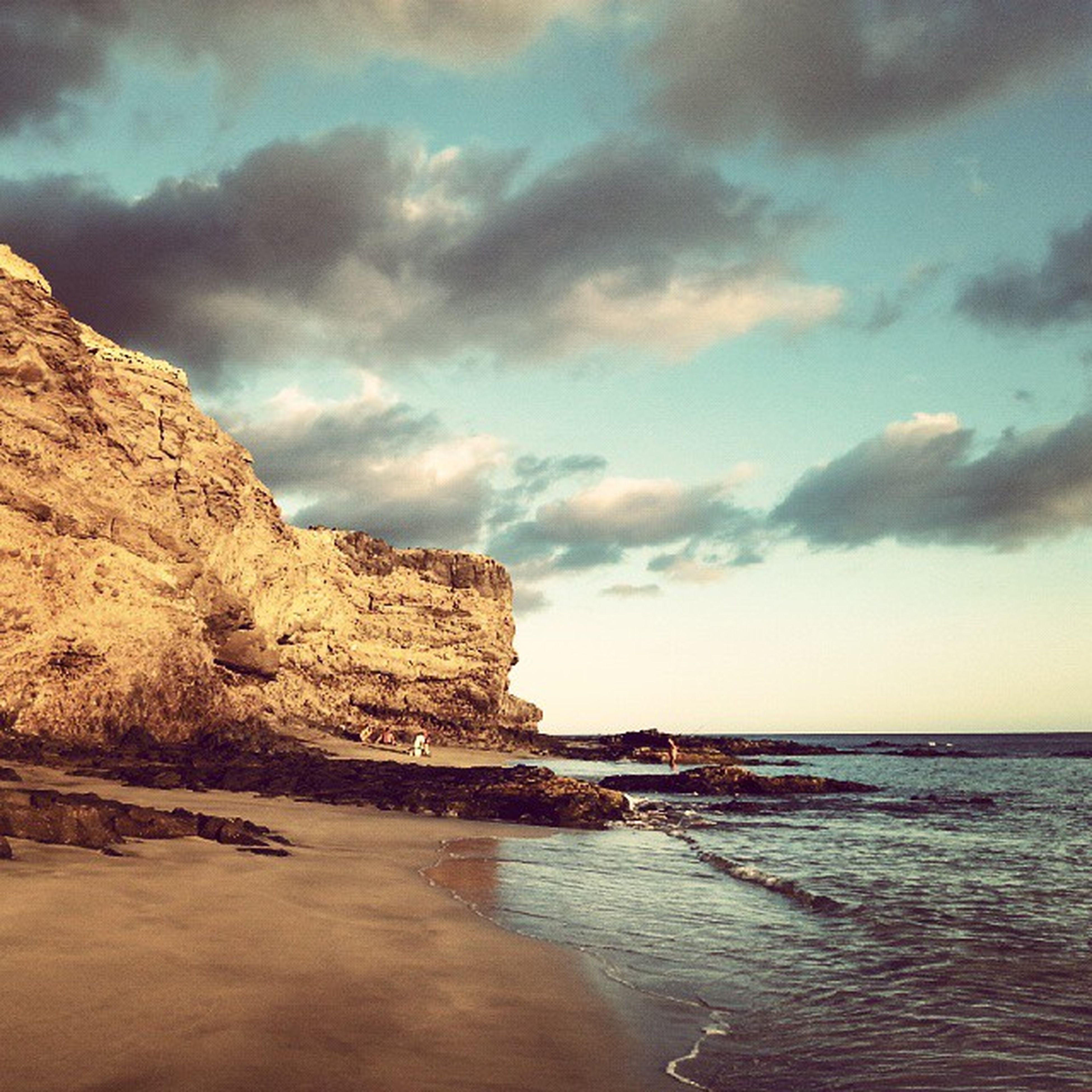 water, sea, sky, scenics, tranquil scene, cloud - sky, beach, tranquility, beauty in nature, horizon over water, rock - object, cloudy, shore, nature, rock formation, cloud, idyllic, waterfront, coastline, outdoors