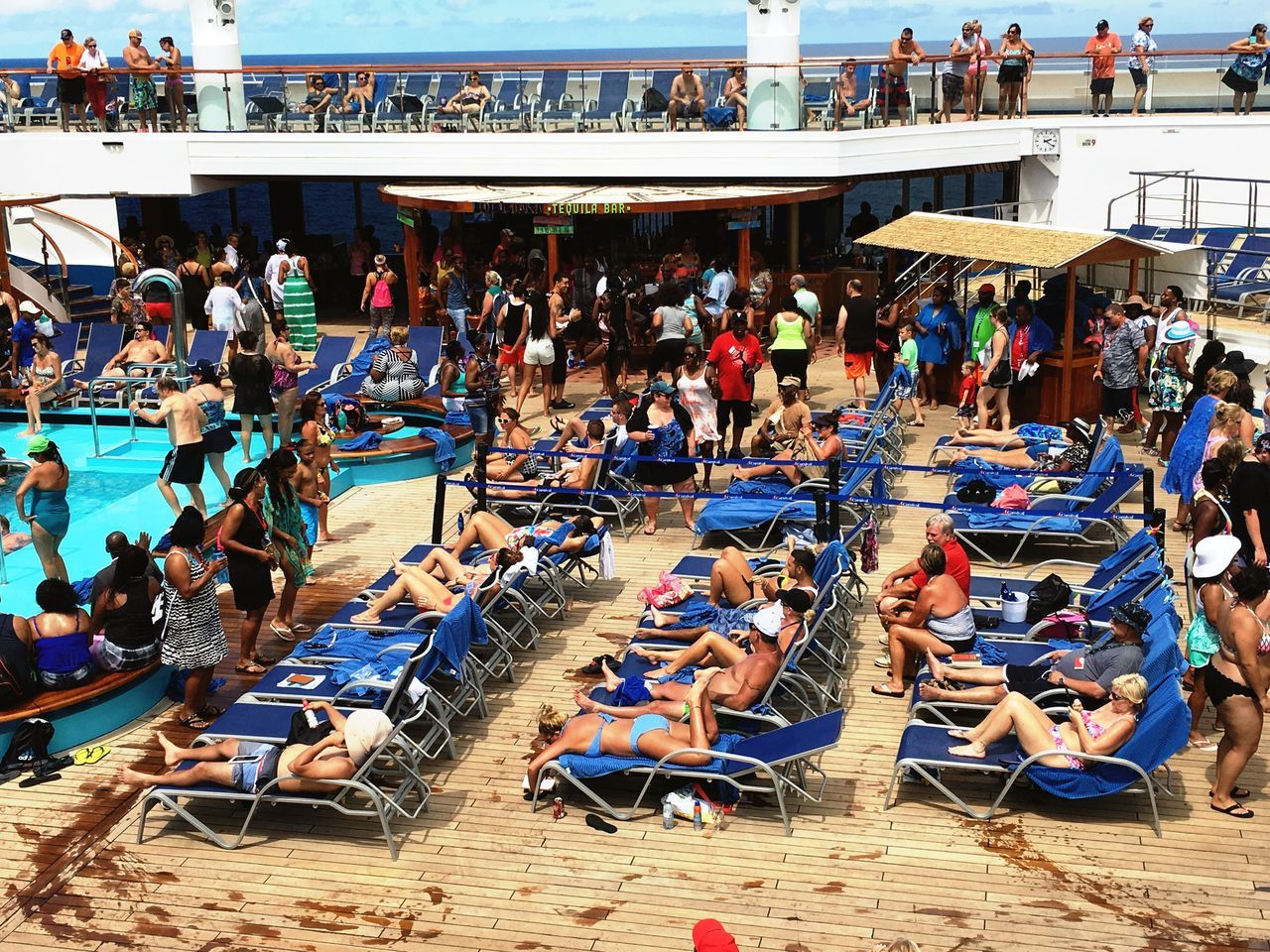 Large Group Of People Vacations Tourism Travel Destinations Outdoors Crowd Men People Day Women Real People Cruise Ship Swimming Pool Fun Dancing Lounging Vacation Relaxing Sunbathing