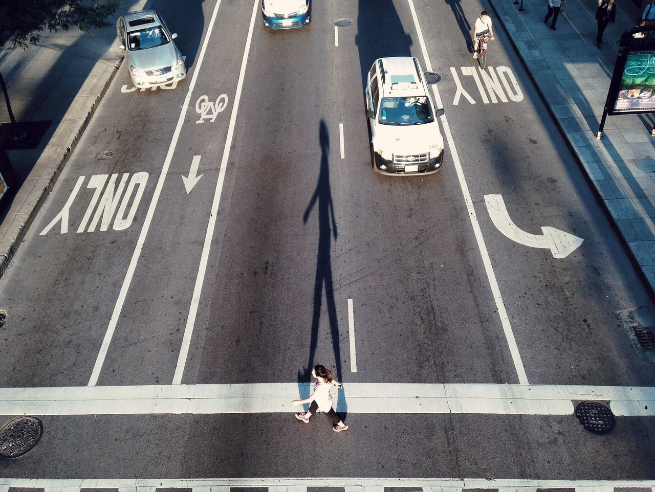 Road Marking Transportation High Angle View Street Road Outdoors One Person Real People Day City Car Women Communication Adults Only People Men Bicycle Lane Adult