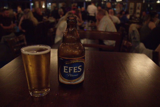 Enjoying a nice drink of Efes in Blackpool, England. I can't believe Efes is cheaper in England compared to what i was paying in Turkey?!?! Drink Refreshment Food And Drink Drinking Glass Indoors  Still Life Western Script Text Alcohol Table Bar Counter Freshness Bar - Drink Establishment Beverage Glass Collection Focus On Foreground Arrangement Efes Efes Pilsen🍺 Efes Pilsner Efes Bira Efesbeer