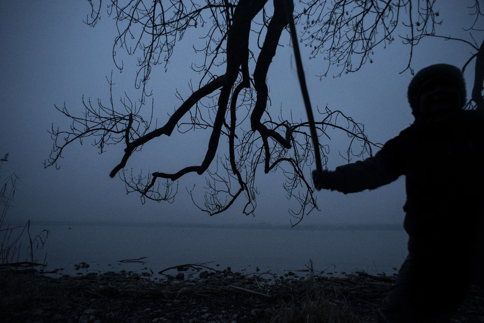 The Big Fight Bare Tree Beach Beauty In Nature Branch Child Childhood Day First Eyeem Photo Horizon Over Water Immagination Kids Nature One Person Outdoors People Scenics Sea Silhouette Sky Tranquil Scene Tranquility Tree Water