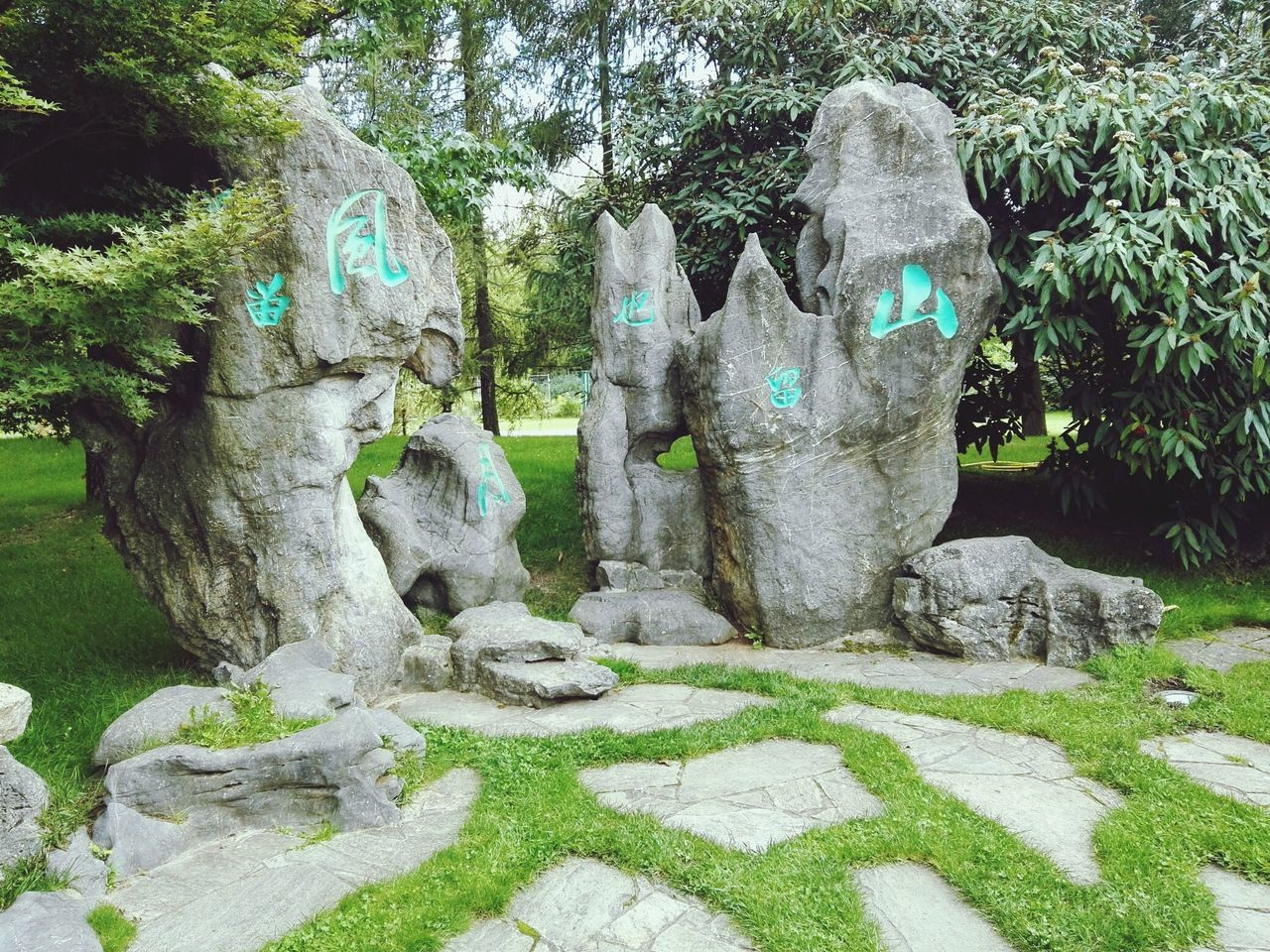 human representation, day, sculpture, no people, rock - object, tree, statue, green color, outdoors, nature, grass, close-up