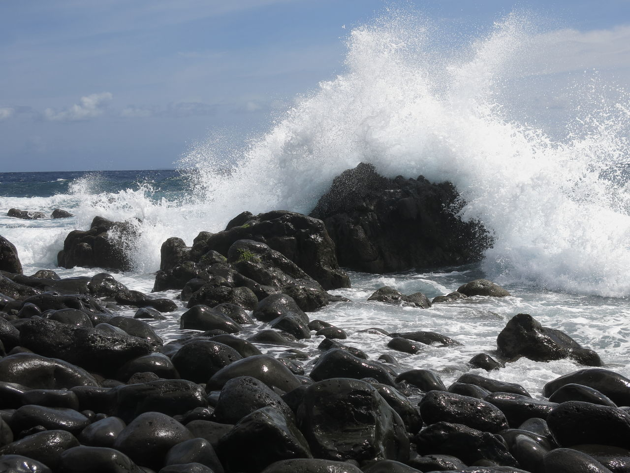 Strong waves arriving on the beach at Canico, island of Madeira Beach Beauty In Nature Black Collision Crash Crashing Day Drops Of Water Hitting Motion Nature No People Ocean Outdoors Pebbles On A Beach Power In Nature Rough Sea Round Shape Sea Splashing Stones And Water Water Wave