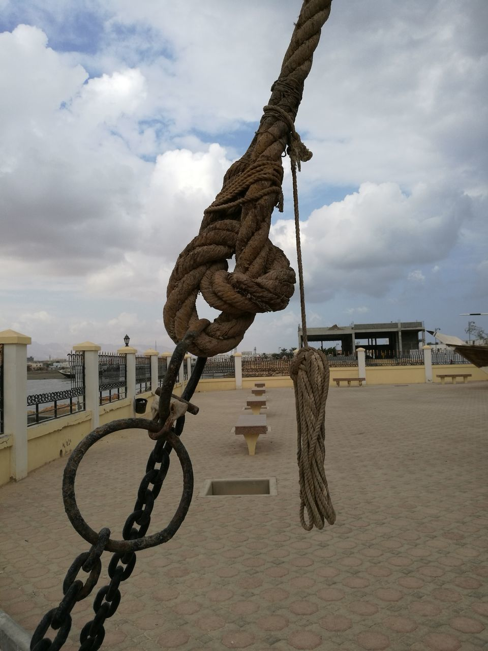 rope, sky, strength, cloud - sky, chain, built structure, day, outdoors, low angle view, architecture, hanging, no people