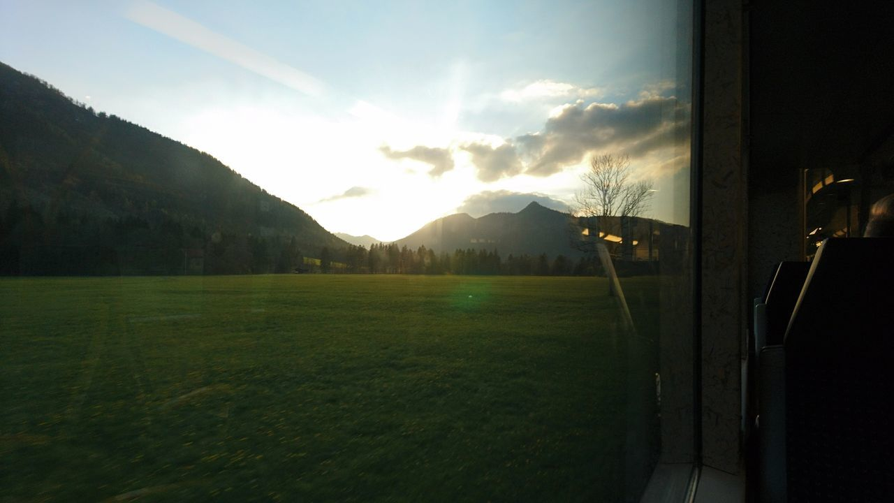 Sunset from the train. · Bavaria Bayern Germany Train Train Ride From A Train Window Sunset Nature Landscape Mountains Lighting