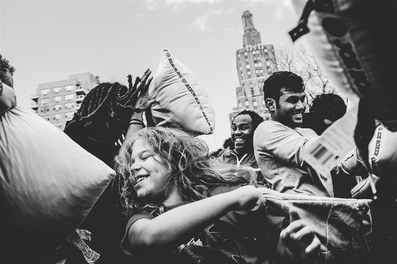 Urban Spring Fever Grittystreets Pillow Fight Washington Square Park Newyork NYC 2016 Streetphotography Urban People Blackandwhite Photography Travel Smile April Showcase Upclose And Personal Teeling A Story Definitely Thestreetphotographer2016eyeemawards