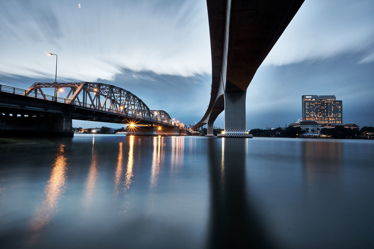 Low Angle View Of Bridges Over River At Dusk