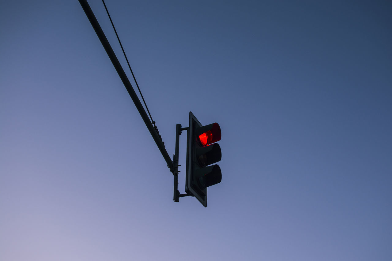 Traffic Light in Berlin Clear Sky Communication Copy Space Day Guidance Illuminated Low Angle View No People Outdoor Photography Outdoors Red Red Light Signal Sky Stoplight The Great Outdoors - 2017 EyeEm Awards Traffic Traffic Lights Transportation