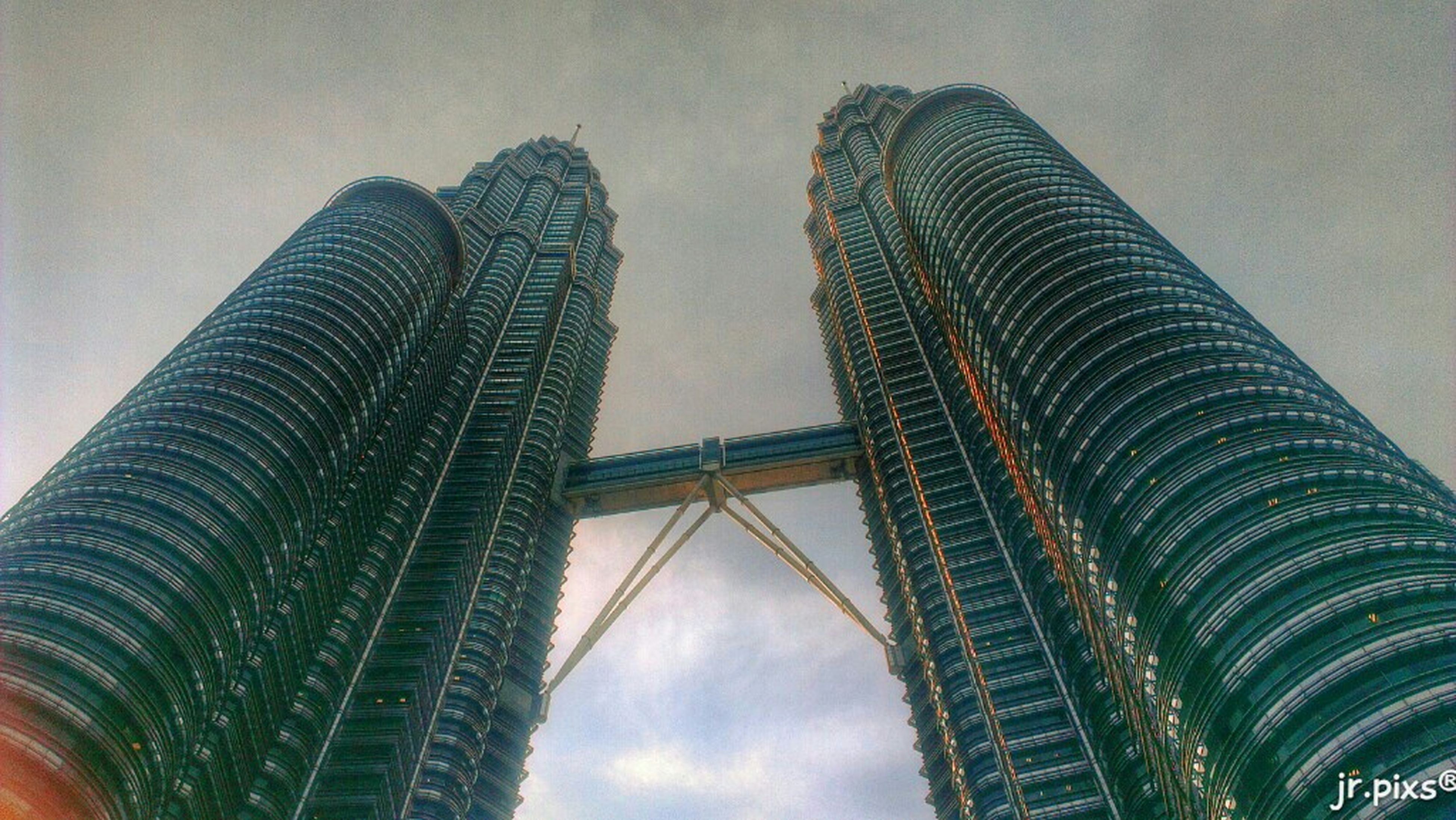 low angle view, architecture, built structure, tall - high, building exterior, skyscraper, sky, modern, tower, city, office building, tree, cloud - sky, building, growth, no people, outdoors, tall, day, cloudy