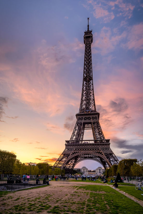 Tour Eiffel City Life Cityscape Eiffel Tower Grass Sunset_collection Tourist Trees Architecture Built Structure City Cloud - Sky Clouds And Sky Day Holiday Huntergol Landscape No People Outdoors Sky Sunset Tourism Tower Travel Destinations