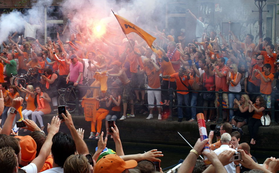 Adult Amsterdam Arjen Robben Audience Boat Can Ceremony Crowd Dutch Dutch Soccer Team Fan - Enthusiast Large Group Of People Match - Sport Men Orange Outdoors People Robben  Smoke - Physical Structure Soccer World Champion World Championship Soccer 2010