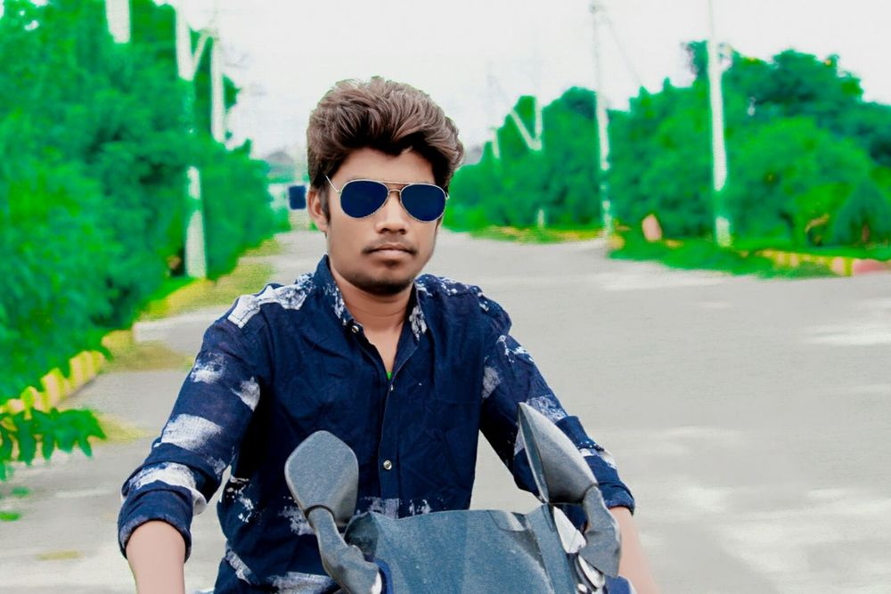 Sitting Sunglasses One Man Only One Young Man Only One Person Adult Only Men Adults Only Young Adult Front View Danger Road People Fashion Portrait Men Cool Attitude Protection Young Men Looking At Camera Outdoors