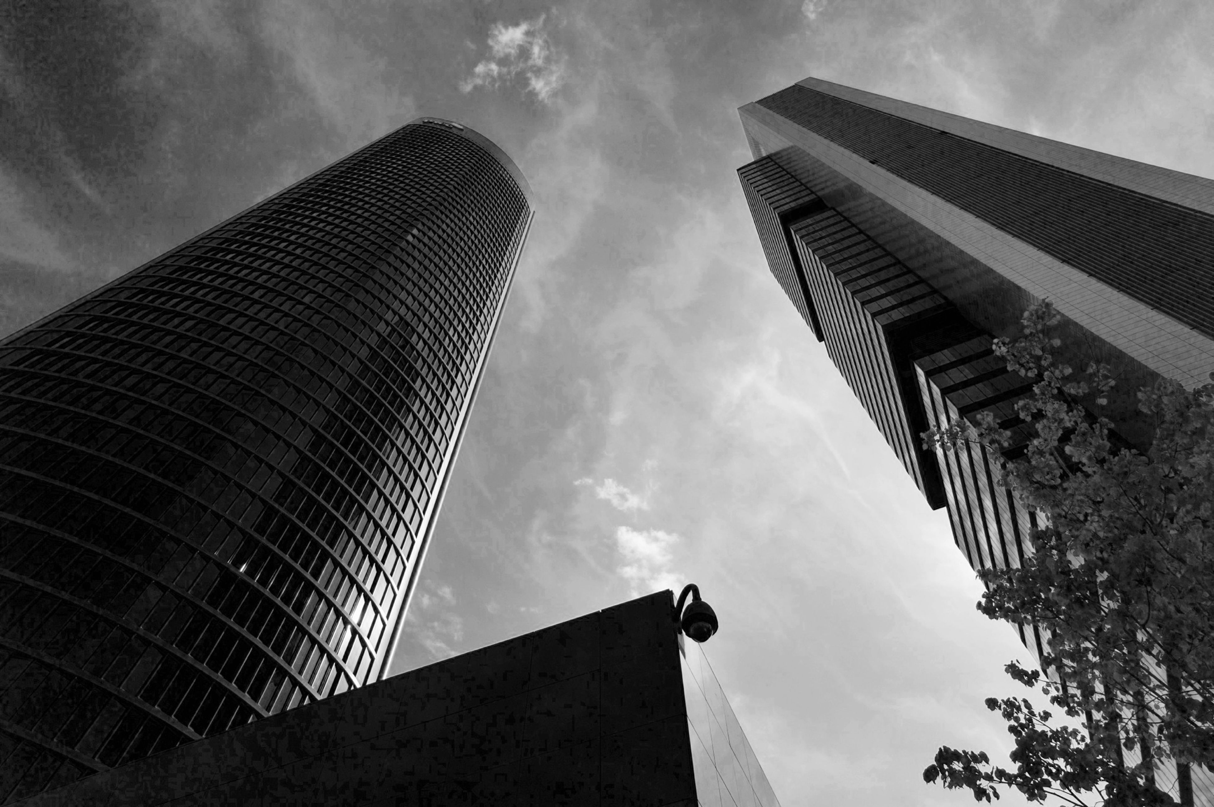 low angle view, architecture, built structure, building exterior, sky, tall - high, skyscraper, modern, city, tower, cloud - sky, office building, building, cloudy, cloud, outdoors, day, no people, capital cities, tall