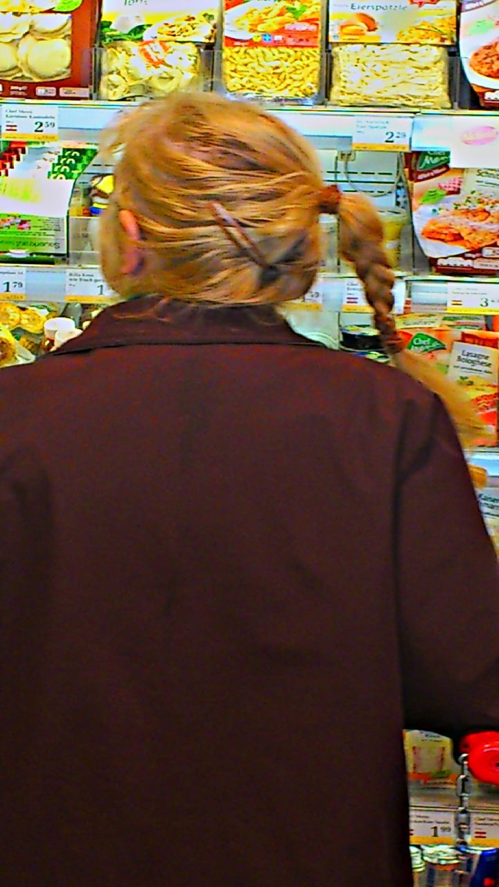 retail, choice, customer, rear view, consumerism, store, choosing, decisions, indoors, variation, merchandise, leisure activity, one person, real people, standing, supermarket, women, food, day, adult, adults only, people