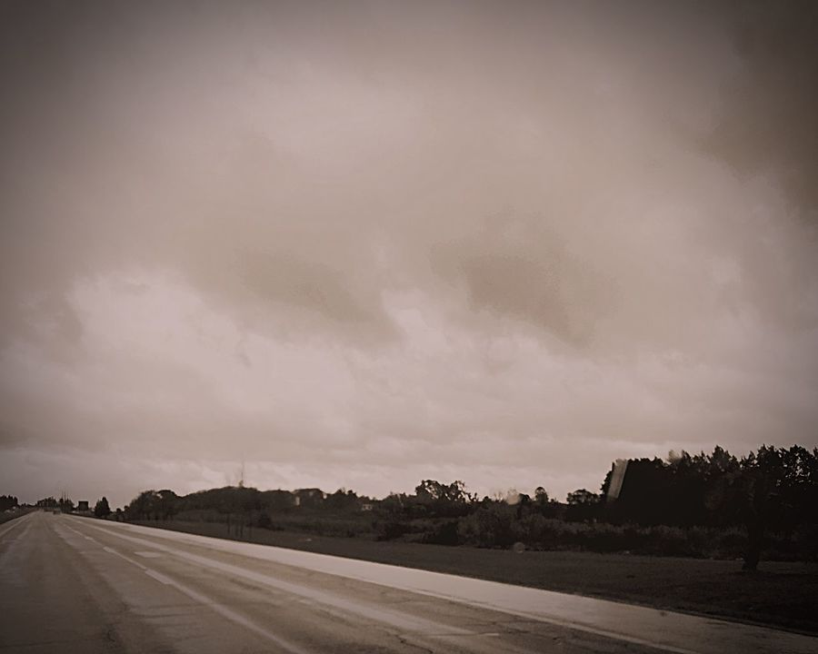 Road Road Marking Empty The Way Forward Landscape Cloud Long Country Road Dividing Line Outdoors Cloud - Sky Cloudy Beauty In Nature Field Scenics Home Is Where The Art Is