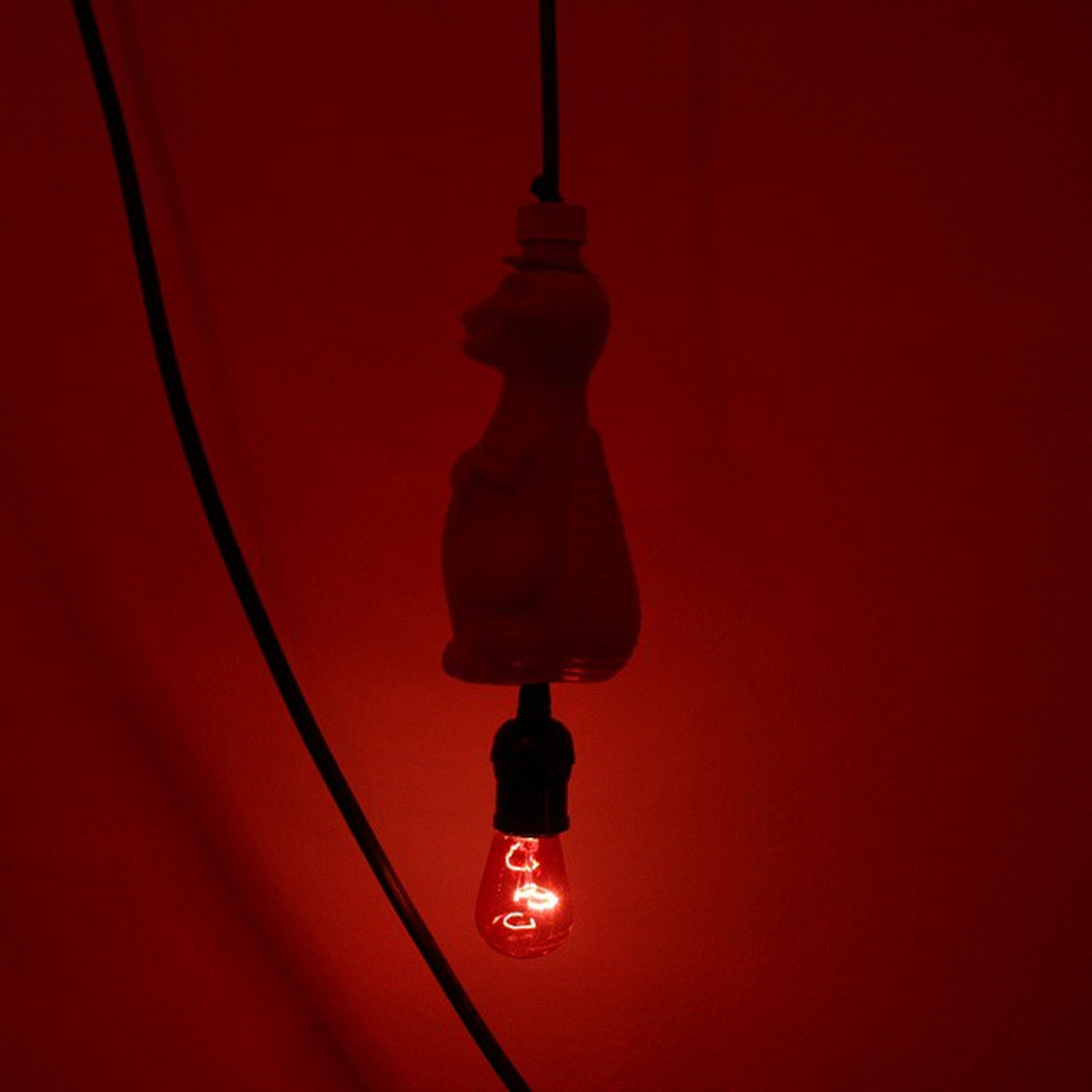 red, indoors, lighting equipment, low angle view, illuminated, hanging, copy space, lantern, orange color, no people, close-up, electric light, electricity, ceiling, travel, part of, technology, wall - building feature, pattern, single object