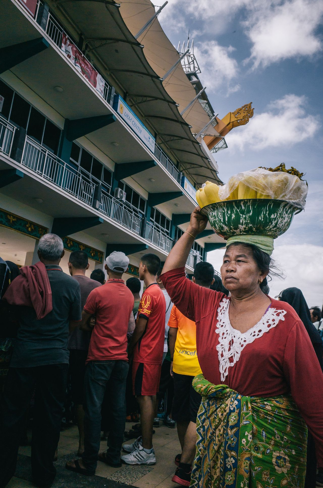 A woman selling corn on the cob Traditional Clothing Lifestyles Real People Women Architecture Sky Day Adult Indoors  People Adults Only The Street Photographer - 2017 EyeEm Awards