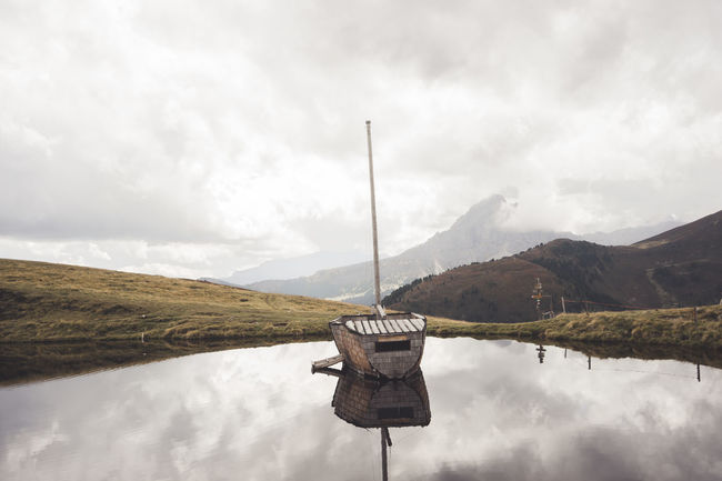 Beauty In Nature Boat Cloud - Sky Clouds Day Hiking Horizontal Lake Landscape Mountain Mountain Range Nature Nature No People Outdoors Reflection Sky Sky And Clouds Water