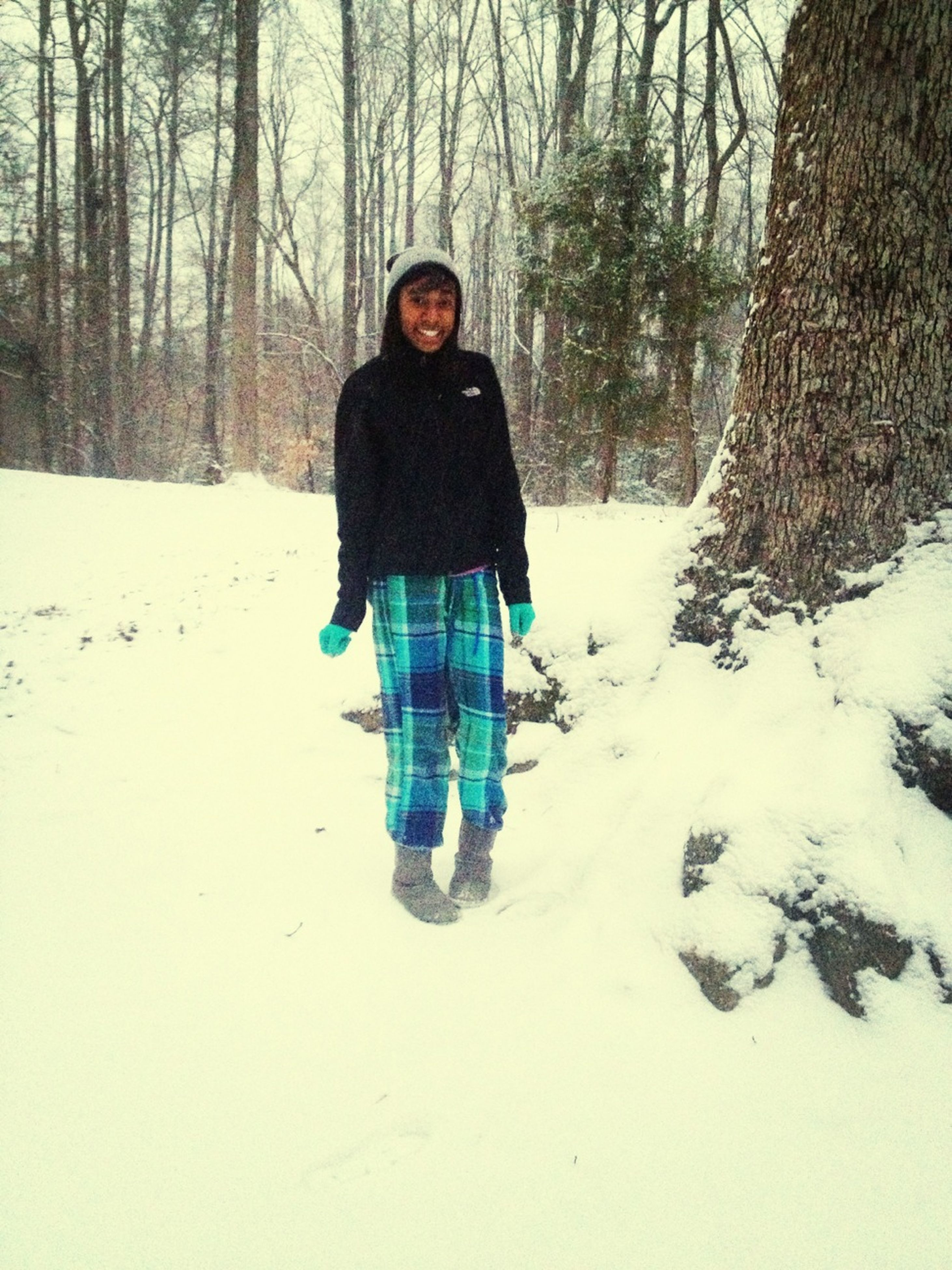 snow, winter, cold temperature, season, tree, lifestyles, warm clothing, weather, leisure activity, covering, full length, front view, white color, forest, nature, tree trunk, covered, tranquility