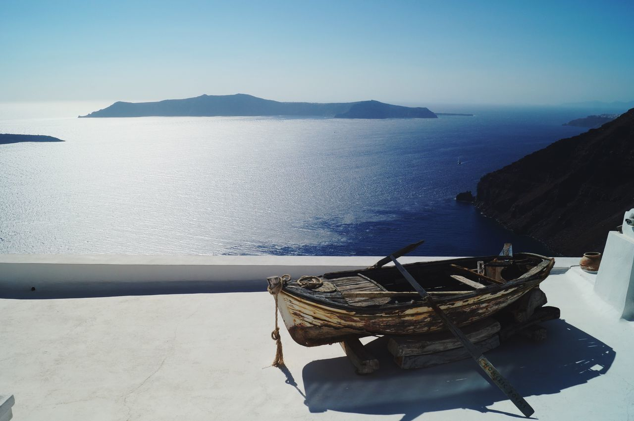 Water Sea Tranquil Scene Scenics Tranquility Boat Transportation Nautical Vessel Beauty In Nature Clear Sky Mode Of Transport Mountain Idyllic Non-urban Scene Remote Peace Whitewash Mountain Range Sky Outdoors Santorini Greece Daydream Paradise Nature Seascape