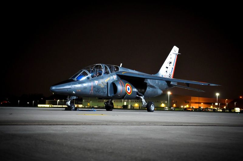Alpha Jet Airplane Air Vehicle Airport Runway Military Transportation Clear Sky Night Military Airplane Illuminated Outdoors Aerospace Industry Air Force