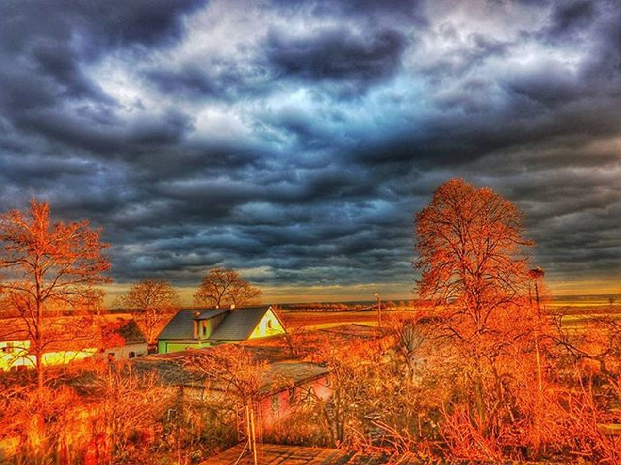 tree, cloud - sky, dramatic sky, sky, weather, outdoors, no people, nature, environment, storm cloud, landscape, field, tranquility, scenics, built structure, beauty in nature, architecture, day, thunderstorm