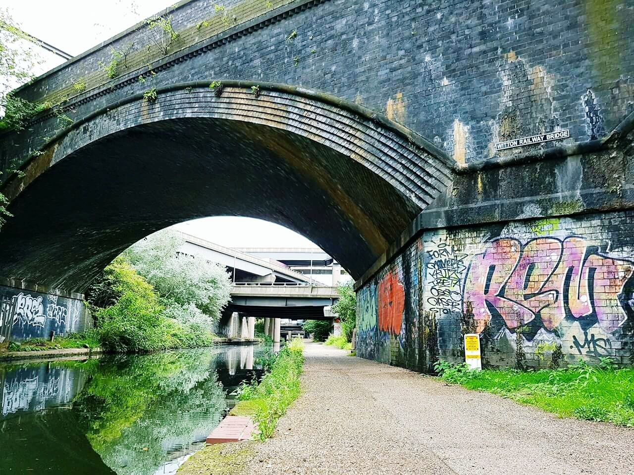 architecture, graffiti, built structure, day, arch, bridge - man made structure, street art, tunnel, outdoors, the way forward, no people, building exterior