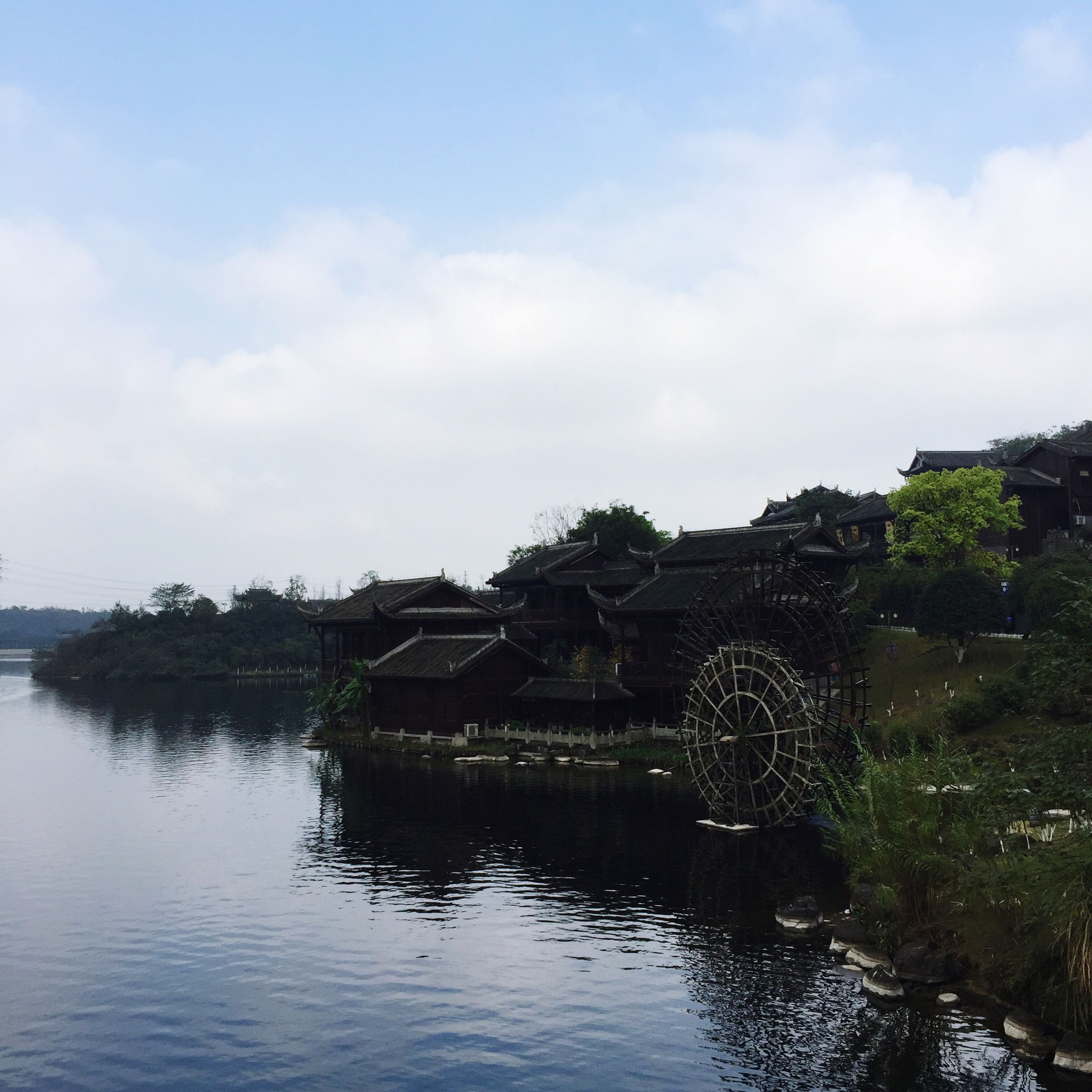 architecture, built structure, water, sky, river, building exterior, tree, waterfront, bridge - man made structure, connection, reflection, cloud - sky, lake, nature, bridge, outdoors, day, cloud, no people, tranquility