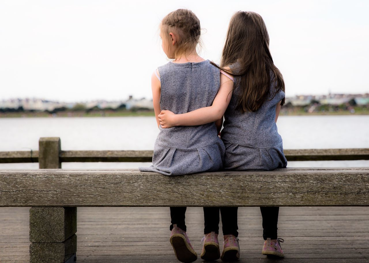 Twin sisters 👭 Twins Hanging Out Relaxing Enjoying Life Crosby Beach Taking Photos The Great Outdoors With Adobe The Portraitist - 2016 EyeEm Awards TWINS ♥ Twin Sisters Sitting Sitting On A Bench People Together